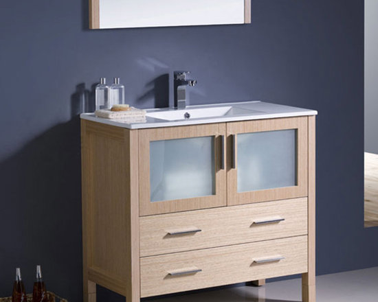 Fresca - Fresca Torino 36 Light Oak Modern Bathroom Vanity w/ Integrated Sink - Suitable for both modern and traditional bathrooms, the Torino 36 vanity from Fresca features a Light Oak finish and frosted glass panels. With a durable and robust construction, this vanity incorporates plenty of storage space for keeping toiletries and bathroom linen neatly hidden away from view. This vanity includes the integrated ceramic sink, which provides a neat finish. Torino Bathroom Vanity Details:   Dimensions: Vanity 35 3/4W x 18 1/8D x 33 3/4H Material: Plywood with Veneer, integrated ceramic sink Finish: Light Oak Please note: faucets not included