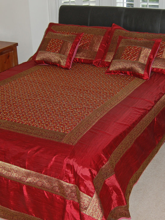 Indian bedding - Embroidered Indian bedspread set in a rich crimson red with a gold silk brocade border. This luxurious five piece bed set consists of a bedspread two pillowcase and two cushion covers. The intricate hand embroidery is truly stunning and this set is sure to add an opulent feel to your bedroom. Suitable for a double or kingsize bed. Size 220cm x 270cm. Cushion covers 40x40cm