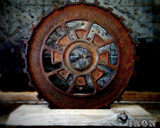 """Antique Industrial Gear Decor - Fantastic old gear of thick rusty cast iron in a hardcore industrial design. Engraved text to make it even more intriguing! Rustic reclaimed lumber display stand. 7 5/8"""" diameter."""
