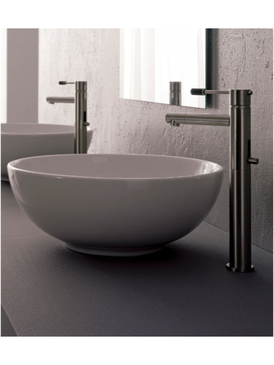 "Scarabeo - Stylish Circular White Ceramic Vessel Sink by Scarabeo - Scarabeo designs and makes this product in Italy. Stylish round above counter vessel sink made of high quality white ceramic. Washbasin comes without overflow or faucet holes. Sink dimensions: 15.40"" (width), 5.90"" (height), 15.40"" (depth)"