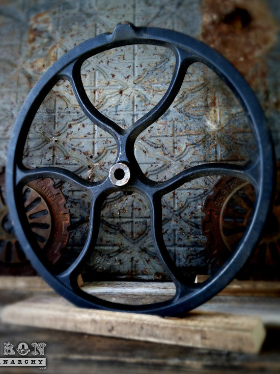 """Antique Industrial Gear Decor - Unique wheel of heavy duty iron with a worn black painted finish. Reclaimed lumber display stand. 12.5"""" diameter."""