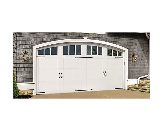 Wood Doors - Our 7000 series Wood Garage Doors are very stylish yet have a simple trim package on the flush door surfaces. All models feature two-sided smooth door sections on a sturdy hemlock frame with an insulated core.