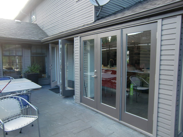Exterior paint grade french triple cantilever folding for Modern french doors exterior