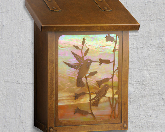 hummingbird Vertical Wall Mounted Mailbox - Everyone loves Hummingbirds and now your friends and family can be greeted by these two beautiful creatures exclusively from America's Finest. Select one of our many hand applied patina finishes and complete the design with a beautiful piece of art glass to create the sky behind. Handmade of solid brass this vertical design of this mailbox is perfect for mounting in a narrow space. It has a traditional hinge detail on the lid and a rubber bumper inside to eliminate any noise when closing. The corner rivets complete the design and give this mailbox it's handcrafted look. Easy to mount and a wonderful addition to your front entry this unique Hummingbird design will be a delight for years to come. As with all America's Finest products it carries our lifetime warranty.