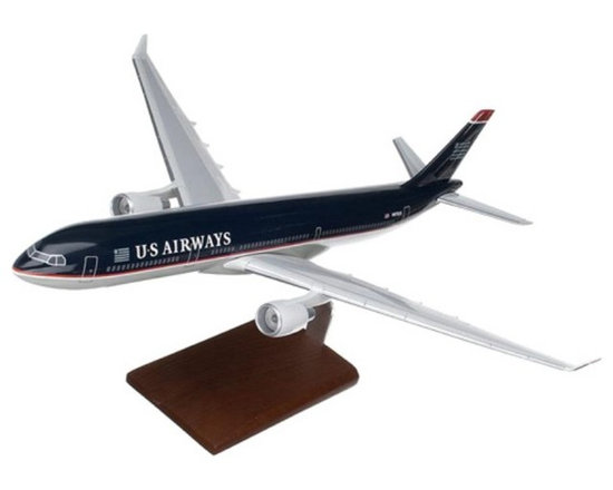 Toys and Models - A330-300 US Airways Multicolor - KA330USATR - Shop for Model Kits from Hayneedle.com! Developed in the early 1990s the Airbus 330 is a very versatile aircraft that operates as a medium- and long-range airliner as well as serving as a freighter jet with an additional military mid-air refueling tanker variant available. A Northrop-Grumman derivative of the A330 tanker variant designated the KC-45 won a U.S. Air Force contract a rarity for a non-American built modern aircraft. While the contract was later canceled a number of militaries around the world use the A330 MRTT tanker and transport version. The aircraft modeled here is the A330-300 a newer model introduced in 1993 that can carry anywhere between 295 and 440 passengers depending upon layout. It is presented here with a finely detailed U.S. Airways paint scheme and its high quality construction will make it a welcome addition to any collection.