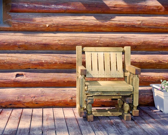 Montana Woodworks - Single Seat Glider in Exterior Stain - Seat glider glides gently back and forth. Hand crafted. Timbers and trim pieces. Sawn square for rustic timber frame design. Heirloom quality. Durable build, fit and finish. Made from American solid wood and lodge pole pine. Ready to finish. Made in USA. Minimal assembly required. . 32 in. W x 36 in. D x 34 in. H (75 lbs.). Use and Care Instructions. WarrantyThe perfect addition to any porch or deck. A glider made especially for the individual.
