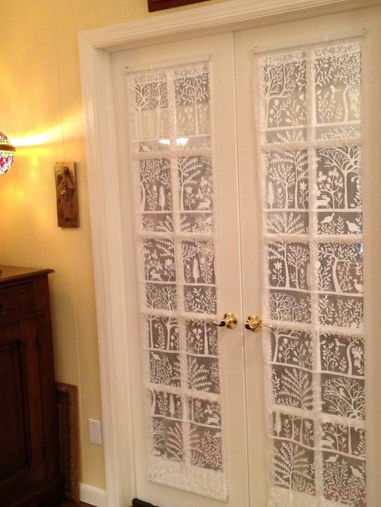 """Our Customers. - Our customer Kem who lives in Haskell NJ sent this image of our very contemporary lace pattern """"Rabbit Hollow"""" used as lace door panels on French Doors leading to her dining room.  She had cut them down to size from 84 inch length Lace Panels and sewed in a rod pocket on the bottom."""