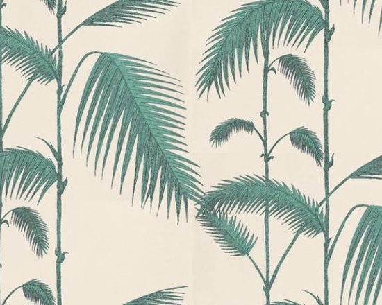 Palm Leaves Wallpaper by Cole & Son - This classic Cole & Son wallpaper pattern features a stunning large palm leaf print on plain grounds. Presented in eight colour-ways including green on blue, ivory, yellow or luxurious gold on black.