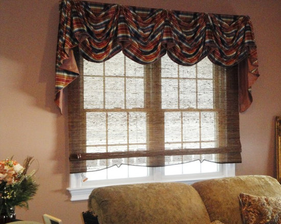 Design Expectations - Custom Valance on a rod with panels framed this french door to the backyard.  We complimented the windows with a French Pickup Valance with a woven shade .