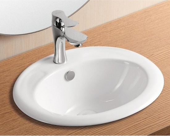 "Caracalla - Self Rimming Oval White Ceramic Bathroom Sink by Caracalla - Simple oval shaped self rimming bathroom sink made of high quality white ceramic. Contemporary sink designed in Italy by Caracalla. Includes overflow and a single faucet hole. Sink dimensions: 18.70"" (width), 7.28"" (height), 16.54"" (depth)"