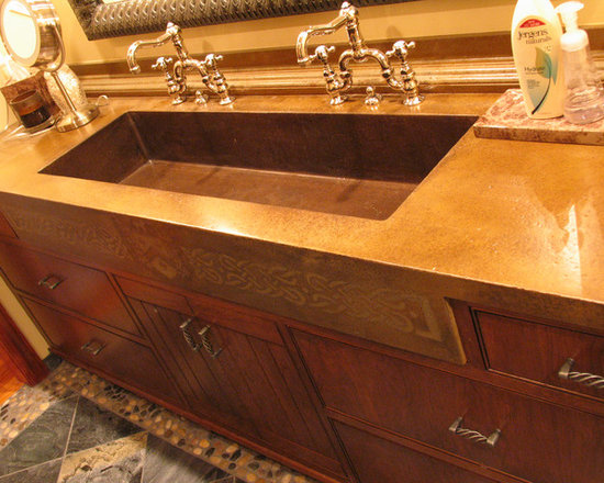 Concrete Bathrooms - Concrete vanity with integral sink, apron front with Family Crest.  Personalization.  Honed texture