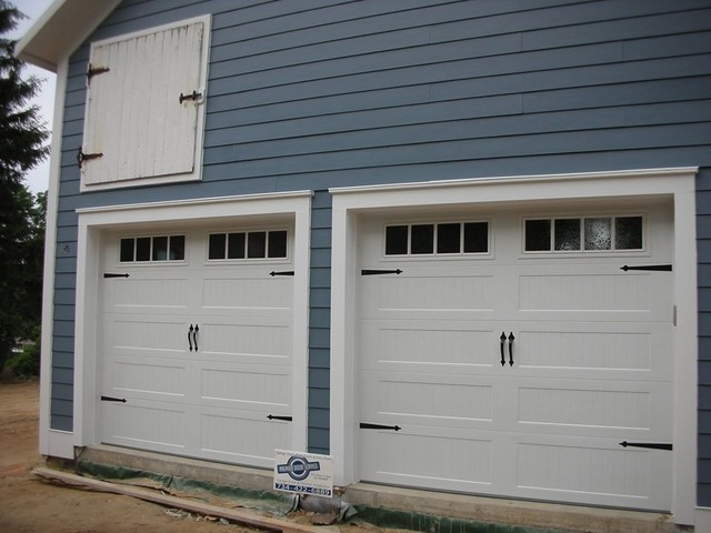 Carriage house garage doors farmhouse garage and shed for Farmhouse garage doors