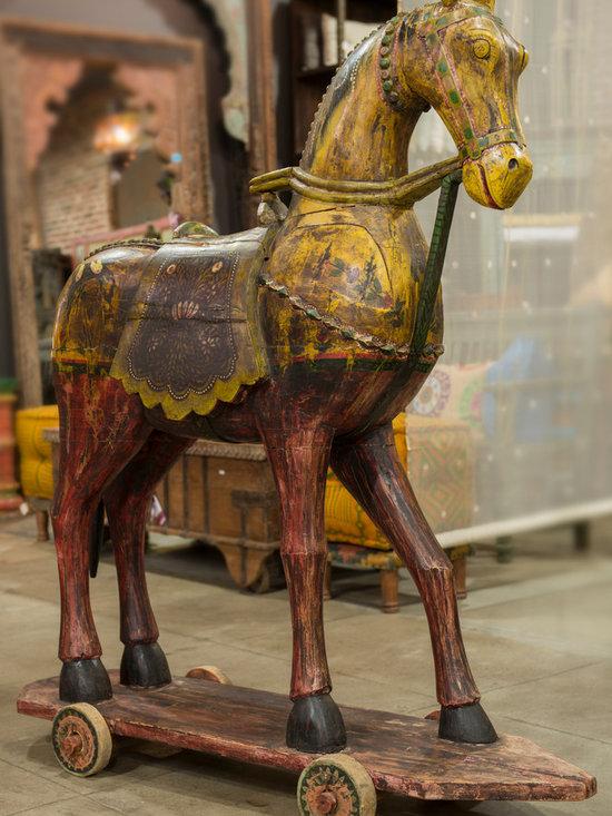 de-cor store - Antique polychrome wooden Horse on original wooden castors.