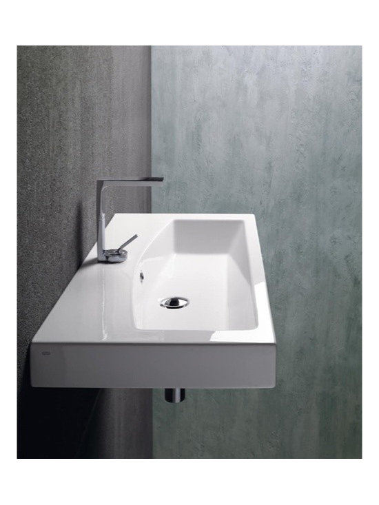"GSI - Modern Wall Mounted, Vessel, or Self Rimming Ceramic Bathroom Sink by GSI - This beautiful modern rectangular bathroom sink is made out of high quality white ceramic. It is designed and made in Italy by GSI. Sink can be installed and used as either a wall mounted, above counter vessel, or self rimming sink. It includes overflow and comes with either one faucet hole (as shown), no hole, or 3 holes. Sink dimensions: 29.70"" (width), 6.30"" (height), 16.70"" (depth)"
