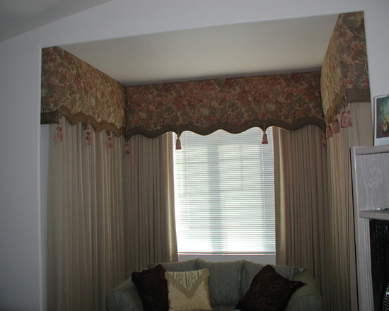 Cornice boxes - Shaped cornice boxes with contrasting border at the bottom designed  to fit the recess. Pleated traversing draperies beneath.