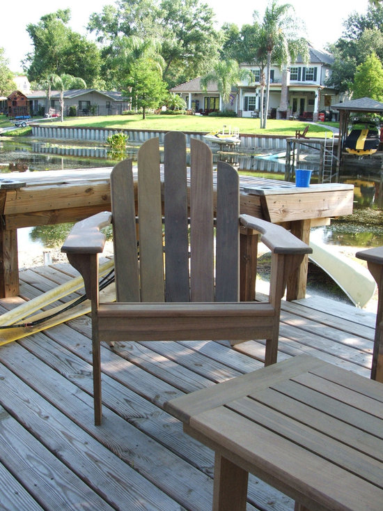 Ipe Adirondack chair - Adirondack set made of Ipe. Ipe Is a hardwood from South America. This lumber is very heavy per foot as compared to other lumber and it is extremely hard. It is one of the very best materials for outdoor use. We use exterior grade hardware on the chairs and tables. The chairs are available in their natural color and the will grey gracefully over time.