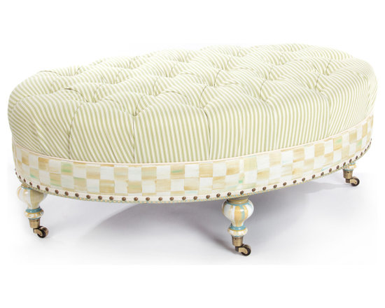 "Parchment Check Underpinnings Oval Ottoman | MacKenzie-Childs - In what we like to call our ""new neutral"" palette, we've taken our successful new pattern—Parchment Check™—and exquisitely printed it in Italy on highest-quality cotton viscose. Parchment Check™ blends tones of ivory, wheat, ochres, and aquas, and has been widely accepted as our new hallmark. We playfully mix it with ticking stripes and hand-painted elements for a furniture line that is soft, elegant, and adaptable to so many settings. Think Downton Abbey meets Big Sur. The Parchment Check™ Underpinnings Collection is lovely and demure, yet energetic and unique. Inspired by the grand hotels of the 1920s, this ottoman is a great accent to any room. Made in the U.S., all Underpinnings pieces feature an eco-friendly frame of sustainably harvested hardwood and eight-way hand-tied coil construction for outstanding comfort. All green-manufactured in our commitment to domestic manufacturing and responsible practices."