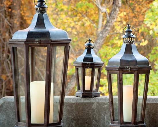 Hillcrest Lantern (Set of 3) - A virtual family of lanterns – small, medium and large – fashioned of stained wood with an arabesque metal top. Stellar together but just as stunning as individuals.