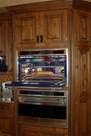 Tuscan-Style Custom Home mediterranean-kitchen
