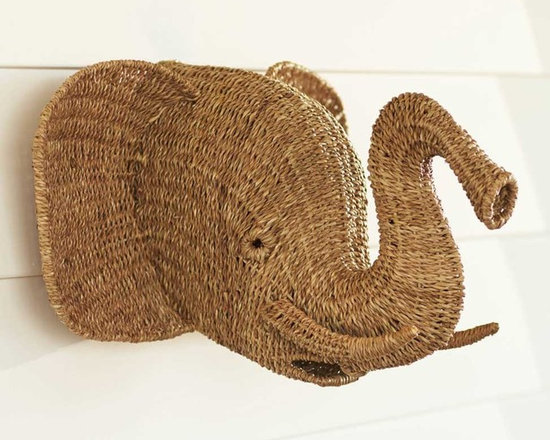 "Viva Terra - Rattan Elephant - With a curved trunk and tusks, this pleasing pachyderm is made from handwoven rattan. 20""W x 18""D x 14""H"