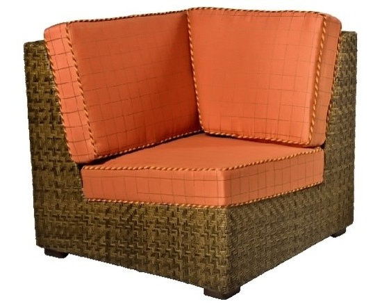 Woodard - Domino Wicker Corner Lounge Chair (Honey Wheat Wicker) - Fabric: Honey Wheat Wicker. With cushions. Inhibitors added to prevent mildew growth and fading from the sun (UV stabilized). Stretch resistant - unsurpassed tensile strength resists sagging or stretching. Soil and scratch resistant - protected against soiling and abrasion from normal usage. Easy to maintain with a solution of water and mild detergent. Made from wicker. Seat height: 18 in. H. 29.5 in. W x 35 in. D x 34 in. H (45 lbs.). All products are made to order. Orders cannot be cancelled after 5 calendar days. If order is cancelled after 5 calendar days, a 50% restocking fee will be appliedSupreme comfort and generous dimensions give this space-saving outdoor lounge a deserved spot in your porch or patio lineup. Both wicker frame and soft cushions have customized color options. Armless corner chair add flair & exotic appeal to your porch, poolside and elsewhere.
