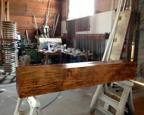 A Rustic Hand Hewn Mantel - A little stain and a good finish 3 to 4 coats of conversion varnish and there we have the finished piece ready to install.