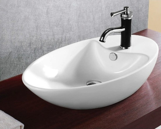 "Caracalla - Oval Bowl Shaped Ceramic Vessel Sink by Caracalla - Contemporary bowl shaped above counter vessel sink designed in Italy by Caracalla. Oval bathroom sink made out of high quality white ceramic. Sink includes overflow and a single faucet hole. Sink dimensions: 28.35"" (width), 7.09"" (height), 15.75"" (depth)"