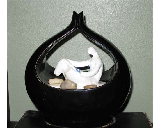 "8"" Poly Resin Tabletop Fountain - This euro style table top fountain with a black & white lacquer finish. The bubbling water from the sculpture is illuminated with an LED underwater light. Made from a durable poly-resin and includes a pump lighting and stone."