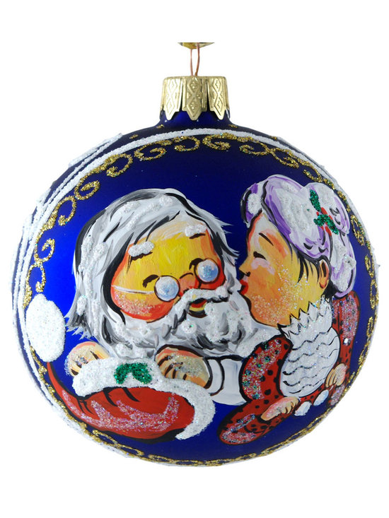 """Santa Claus and Mrs. Claus"" Hand Painted Christmas Ornament - ""Santa Claus and Mrs. Claus"" hand painted Christmas ornament is 3.15"" (80 mm) in diameter and made of hand blown glass by artists in Ukraine. This rear and unique ornament depicting Santa Claus and Mrs. Claus on a blue background is a must for any glass Christmas ornament collector. Made in Ukraine."