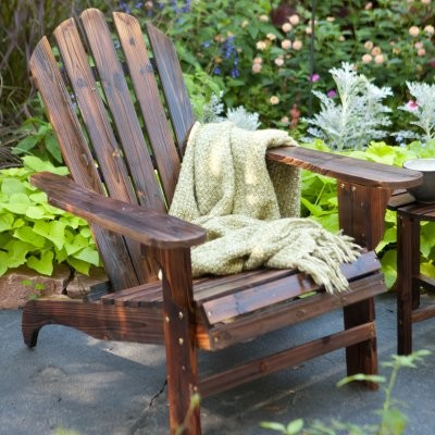 The classic design of the Torched Adirondack Chair invites you to sit down relax modern-task-chairs