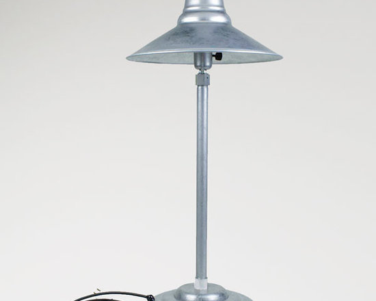 The Astro Retro Desk Lamp - Executives and home office agree, this retro table lamp is loaded with vintage style! Inspired by 1940s desk lamps, ours features flared shade mounted to a weighted base.