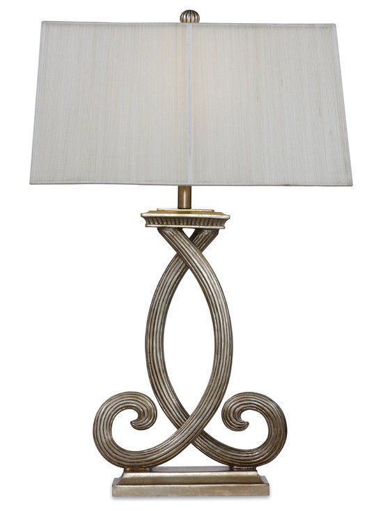 Bassett Mirror - Nala Table Lamp - This charming, old-world inspired table lamp features a vertically textured shade to compliment the overlapping reeded swirl base, finished in antique silver.