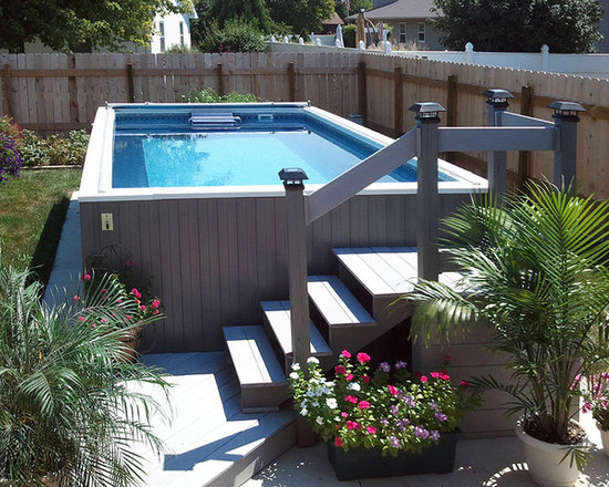 Above Ground Endless Pool® - Your accent landscaping can border only lawn, or it can also surround a compact Endless Pool for year-round swimming, hydrotherapy, and recreation. Unlike most above-ground pools, this Endless Pool's wood siding gracefully blends with the stockade fence.