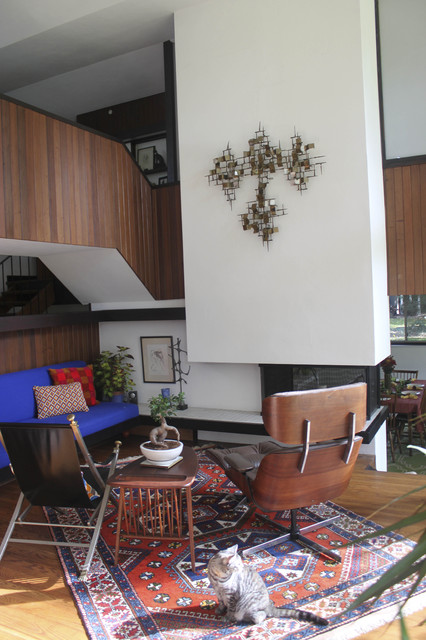 Three sided fireplace in our 1958 Irwin Stein Mid Century Modern Home modern-living-room