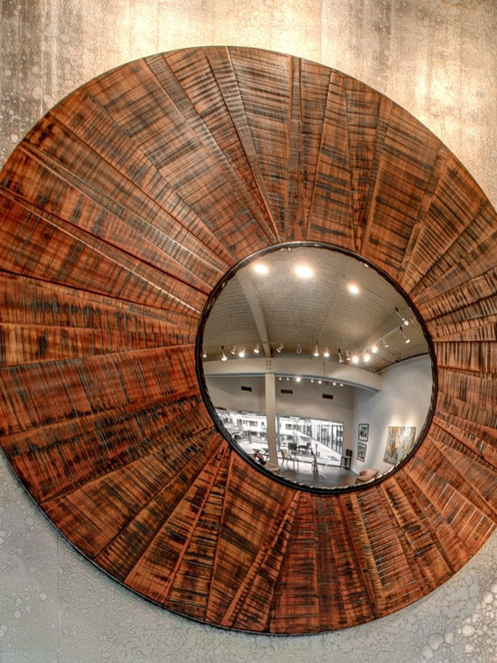 "William & Wayne Showroom - The Sunburst Mirror reinvents the drugstore mirror framing the pedestrian reflector in hand brushed Bubiga wood.  At 66"" diameter it makes a striking statement in any room.  Photo: Red Pants"