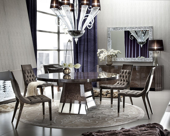 Giorgio Collection - Warm. Inviting. Beautiful. The ABSOLUTE round dining table is everything but ordinary. Japanese Mako with chrome stainless steel accents, this modest yet magnificent fixture from The Giorgio Collection would make a perfect centerpiece for any style room. Crafted in Italy.