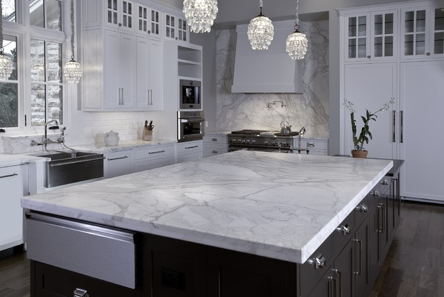 Artisan Stone Collection granite huge island in Calacatta Gold marble contemporary kitchen countertops