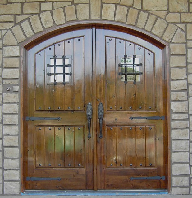 Knotty Alder arched, double door entry. traditional front doors