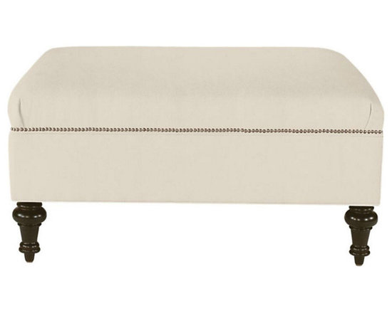 Ballard Designs - Nailhead Ottoman - Large enough to serve as a casual coffee table, each tailored piece is trimmed in handapplied, solid brass studs and sits atop turned maple legs. No Storage.