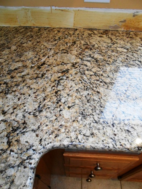 Venetian Ice Granite On Medium Colored Wood Traditional