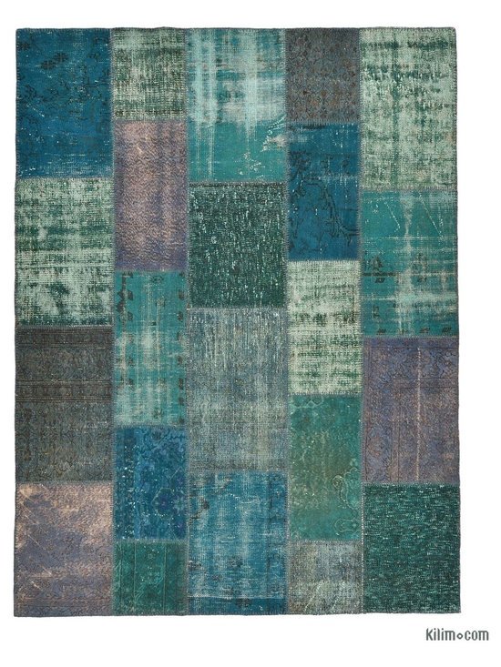 Over-dyed Anatolian Patchwork Rug - This piece is an Over-dyed Anatolian Patchwork Rug created by first neutralizing the colors and then over-dying to achieve a contemporary effect and bring old hand-made rugs back to life. The result is almost like an abstract painting. This piece is backed with cotton cloth as reinforcement.