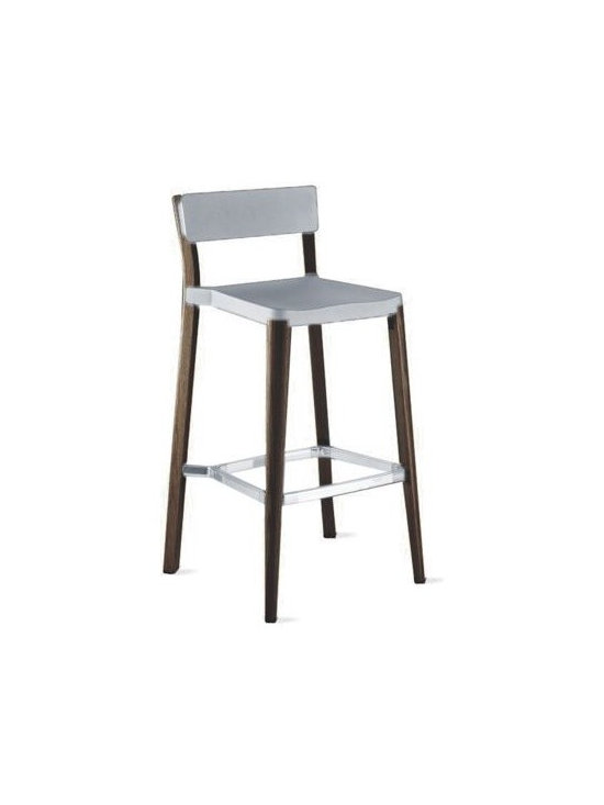 "Emeco - Lancaster Barstool - British designer Michael Young has spent 15 years strengthening the connection between modern design and the technical abilities of manufacturers in Asia. ""I see the work not as design but as industrial art where the highest levels of manufacturing have been employed,"" says the designer. Working from his studio in Hong Kong, Young is known for his expertise in aluminum manufacturing. When he started experimenting with ways to join other materials to aluminum, he contacted U.S.-based Emeco, and a partnership was formed with the Lancaster Collection (2010). The legs are solid ash, harvested from fallen timber near Lancaster, PA (thus the name of the chair); the aluminum seat and back are available in matte black, matte silver or polished silver. ""I am passionate about natural materials that live forever,"" says Young. ""The wood creates a softer edge, whilst the aluminum keeps it sophisticated."" Chairs stack up to six high. Seats/backs made in China; legs made in U.S.A. DWR Exclusive"