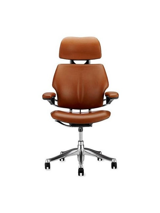 Humanscale - Freedom Task Chair with Headrest in Prima Leather - Niels Diffrient's Freedom Chair (1999) was a breakthrough in ergonomic task seating. With a height-adjustable headrest, the Hi Back version offers customized support for the head, allowing for proper eye-level positioning when working long hours at a computer station. The Freedom Chair is designed to fit almost all body types. The seat depth is adjustable to properly support the seat and thighs, while the adjustable back support helps to keep the lumbar region of the body in line. Often, ergonomic chairs are likely to be improperly positioned, resulting in the creation of more problems than they solve. The Freedom Chair is simpler than other chairs, eliminating many manual adjustments and creating instead a system of internal mechanisms that respond to the user's needs. A unique counterbalancing tilt mechanism self-adjusts according to the user's weight and movement, thus eliminating the need for manual fixes. In addition, the chair and seatback can be easily raised or lowered, and the seat itself moves forward or back. Any adjustments can be easily made while the user is seated for accurate positioning. Because of a natural lift-and-release action, the armrests are effortlessly repositioned depending on the task at hand, and unlike other ergonomic chairs, the armrests work in tandem. The seat cushion provides excellent shock absorption and weight distribution for unmatched comfort. Made in U.S.A.