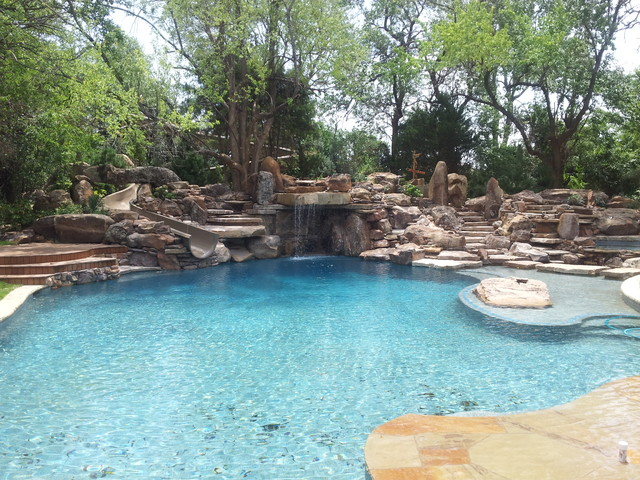 A residential waterpark rustic dallas by natural for Natural rock swimming pools