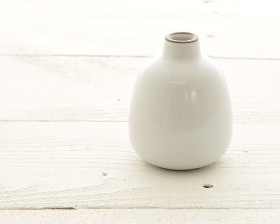 Heath Ceramics bud vase in opaque white - Heath's always popular bud vase shown here in opaque white. Great with a flower inside or just on its own.