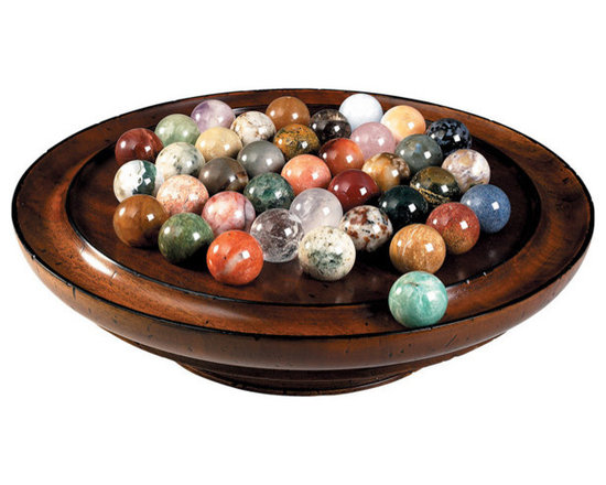 """Inviting Home - Semi-Precious Stones Solitaire - solitaire game with semi-precious stones 13-3/4"""" x 3-5/8"""" 38 semi-precious stone spheres (30mm each) At least 15 different semi-precious minerals. Malachite Azurite Quartz Serpentine Hematite Bloodstone Lazulite Amethyst Crystal Garnet... Try your hand at jewel-like stones with our precious solitaire� All the marbles for this solitare game are mined hand-cut ground and polished by hand in Madagascar. Madagascar is known for its unique variety of minerals. Every mineral is by definition unique giving every Solitaire marble set its own unique character. Configuration depends on season and availability. Your game may contain marbles of the same mineral but of different colors. Depending on the mining season during the time of production this game may include marbles formed of the following minerals: Agate Mousse Amazonite Amphibole Anhydride Apatite (blue green) Aragonite Calcite (blue orange yellow other) Chalcocite Cipolin Colombite Cormaline Crystal Feldspath GalenaGirasol Gneiss Hematoide (red) Jasper (green red yellow other) Labradorite Marble (rose white) Microcline Opal Quartz Rhodonite Septarian Serpentine Sphene Spinel. The game of Solitaire is reputed to have been invented by a nobleman confined in the Bastille prison during the early years of the French Revolution. Solitaire game is played with 36 marbles. The object is to eliminate all but one marble which should ideally end up in the center of the game board. Contents: A collection of 38 (two spares) hand-cut and polished semi-precious marbles selected for color and variety. Game board made of non-endangered hardwood. French finished game board on a small pedestal. To play: Fill all the indents with marbles then remove the center marble and place on the outer ring (fig.). The player begins by selecting a marble that can jump over another marble in either horizontal or vertical directions and land in an empty space. Then the jumped marble is removed and place"""