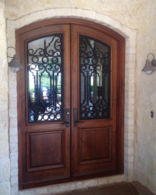 Castille double door rustic front doors other metro for Exterior door companies