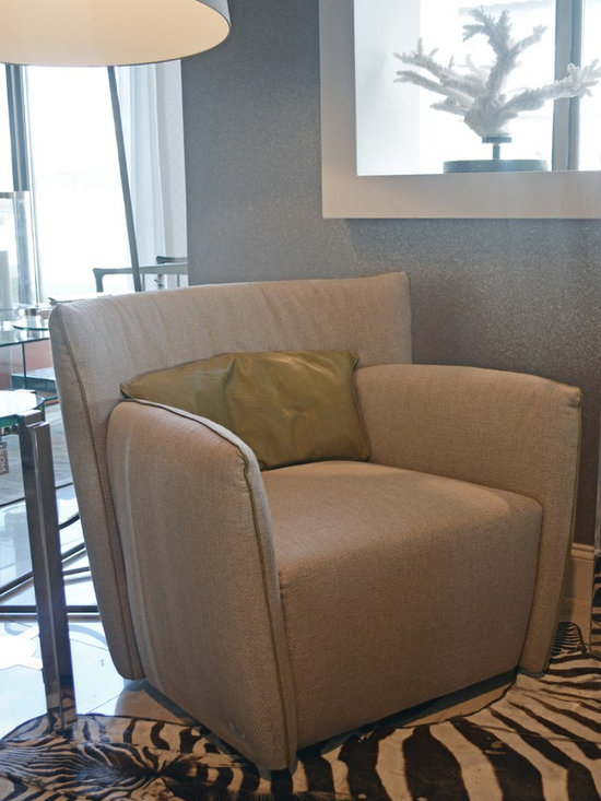Showroom Pieces - Fabric Revolving Armchair with leather pillow