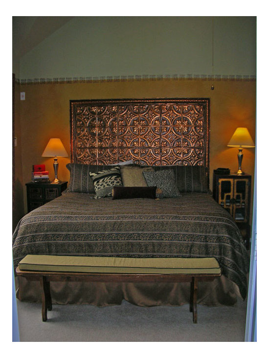 Unique Applications with Tin Ceiling Tiles - A DIY headboard made out of metallic tin tiles.