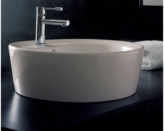 "Scarabeo - Elegant Drop-In White Ceramic Round Sink by Scarabeo - Contemporary design built-in white ceramic bathroom sink. Stylish circular sink includes overflow and a single faucet hole. Designed and manufactured in Italy by Scarabeo. Sink dimensions: 18.10"" (width), 11.80"" (height), 18.10"" (depth)"